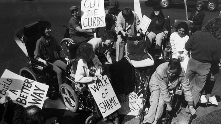 A group protesting against the lack of curb cuts